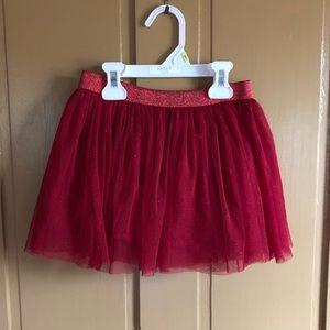 Little girl red tulle skirt.